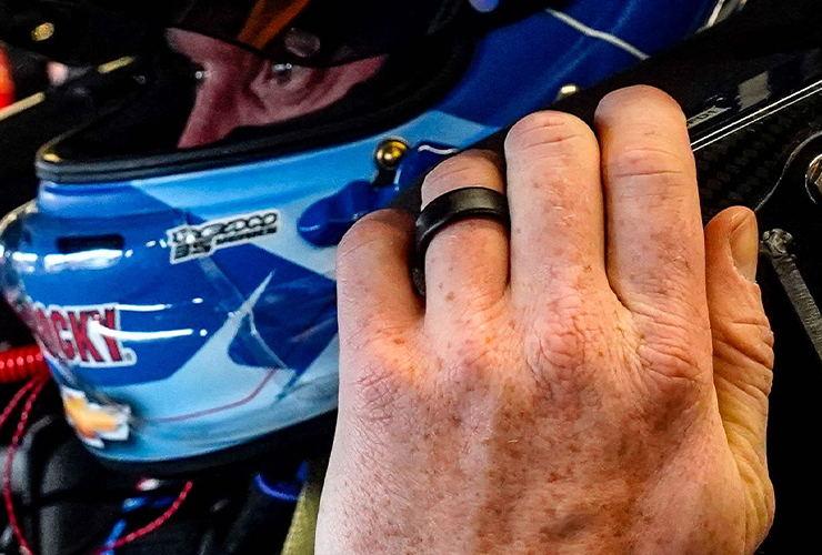 Jeb Burton putting on his racing helmet