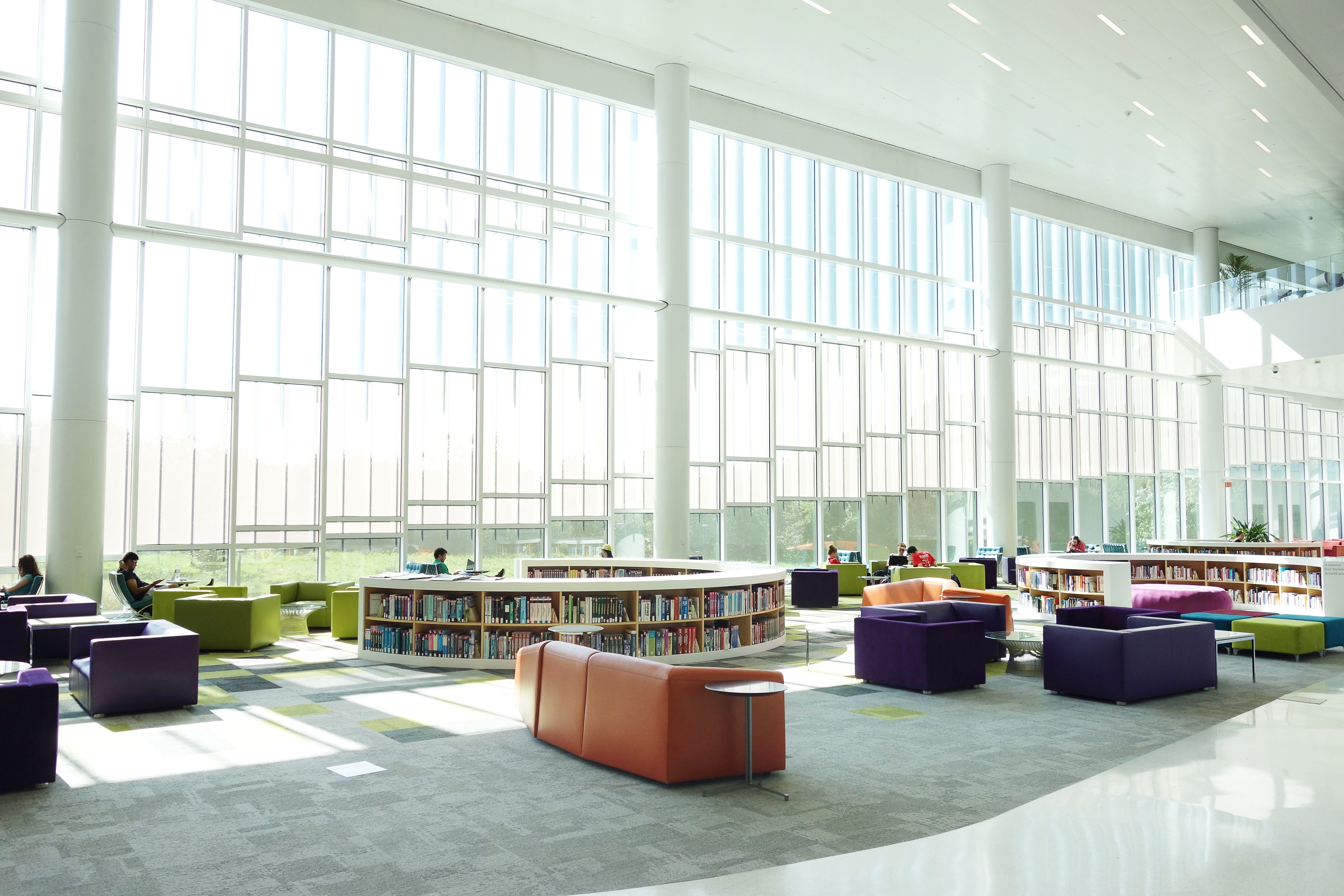 College library with bookshelves and large white windows