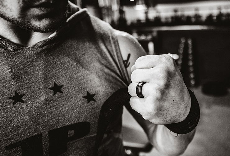 black and white photo of Michael flexing