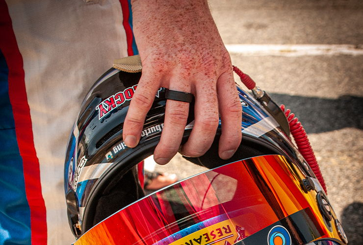 Jeb Burton holding his racing helmet
