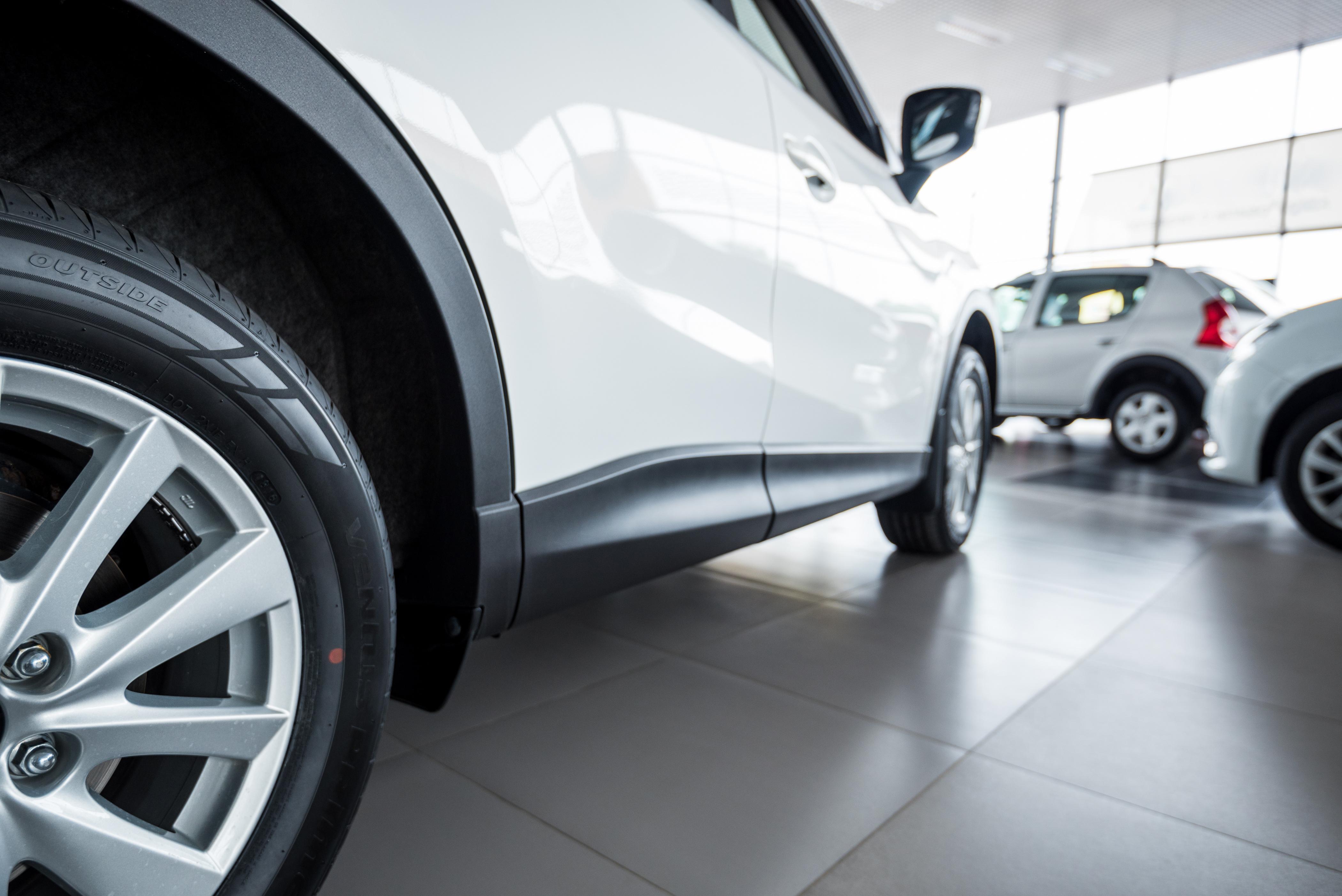 Close up of car in car dealership