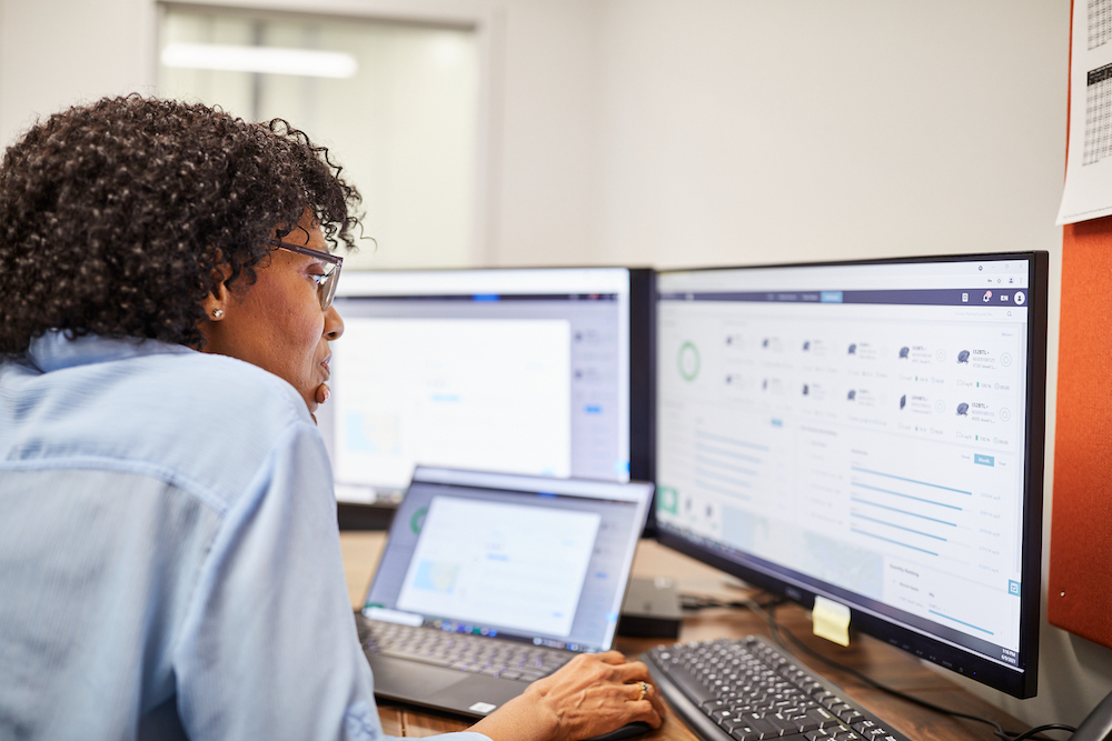 Lady on computer preparing cleaning reports to send to a client