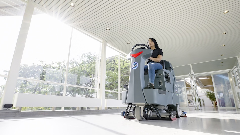 Ride-on scrubber cleaning in building