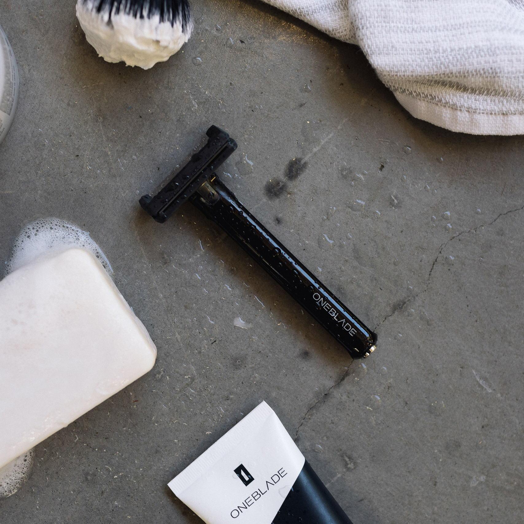OneBlade razor surrounded by soap, OneBlade shaving cream