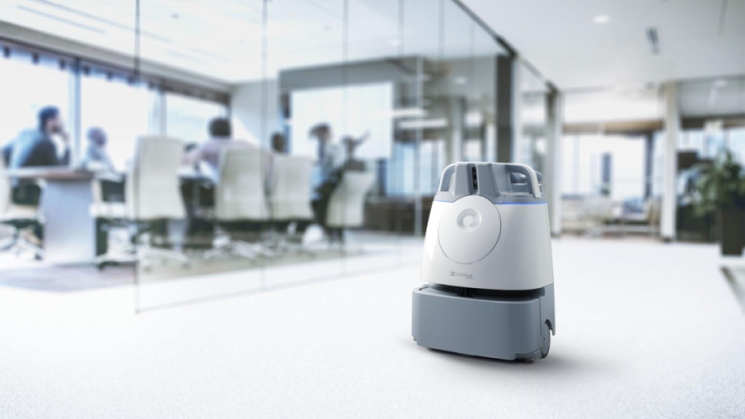 Autonomous vacuum sweeper vacuuming office hallway