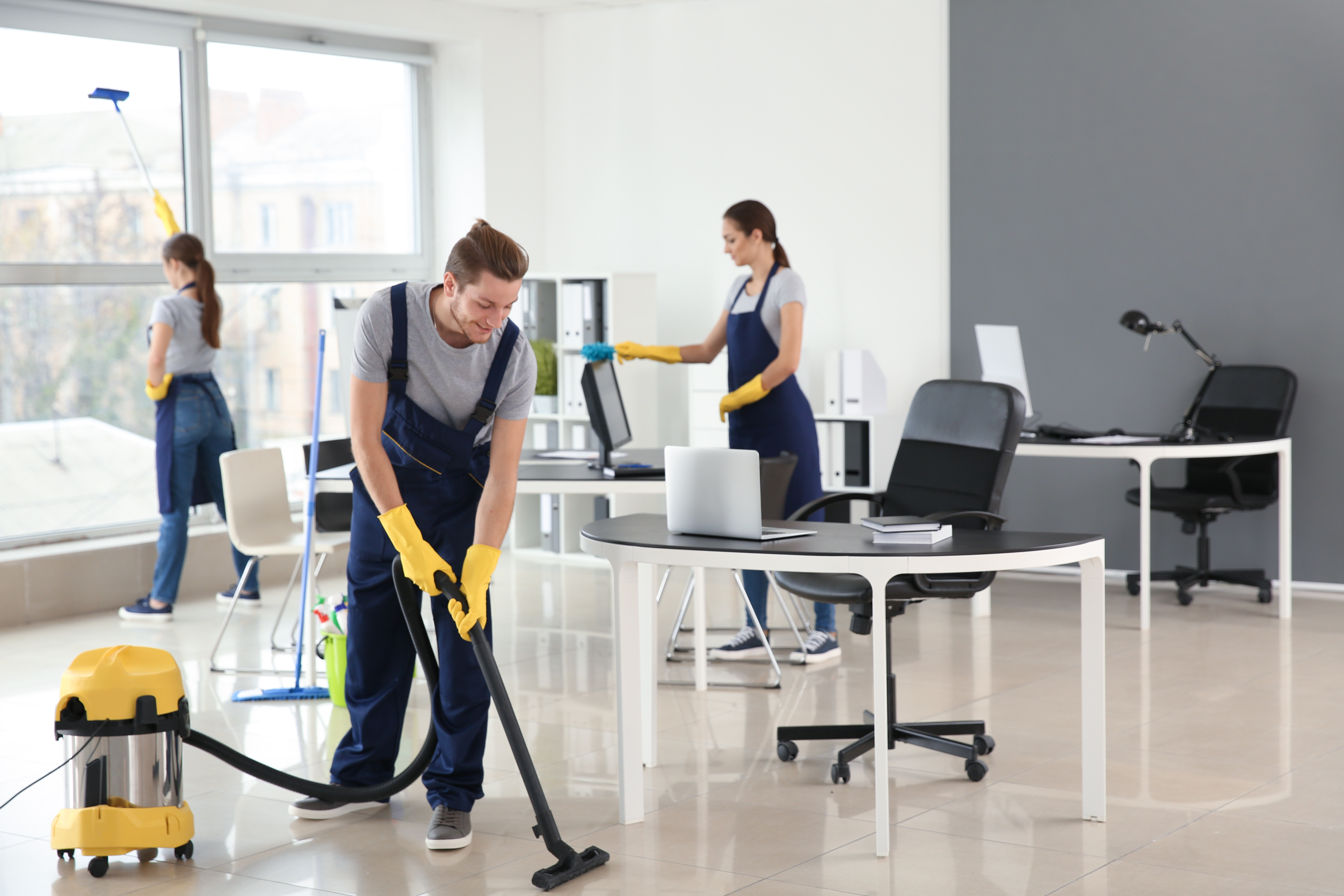 cleaning staff cleaning an office setting