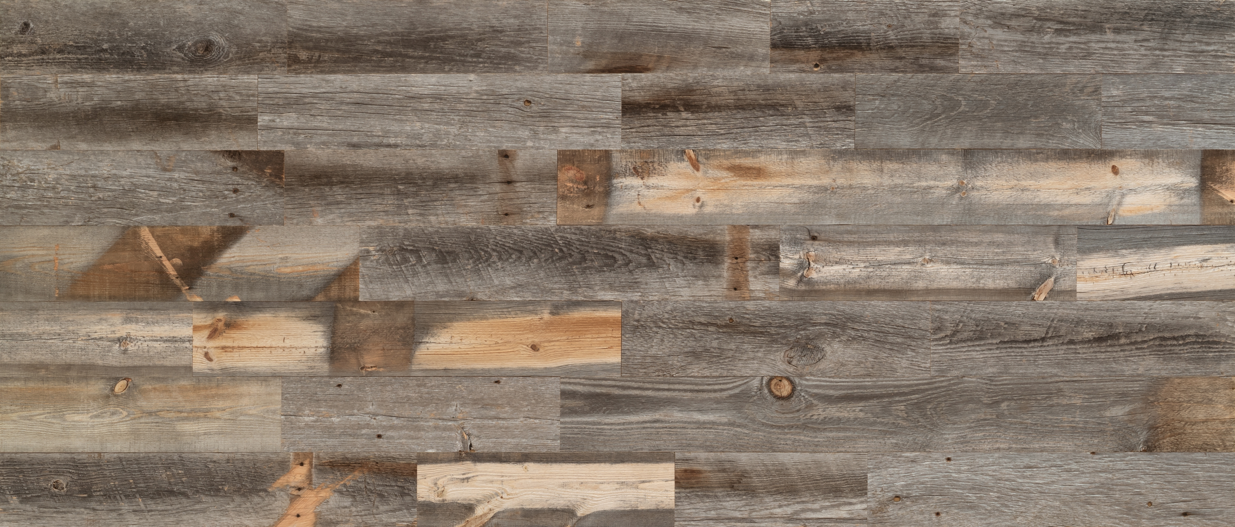 Stikwood Reclaimed Weathered Wood material explorer   real reclaimed barnwood pine peel and stick wood wall and ceiling planks with silver, gray, tan and brown colors.